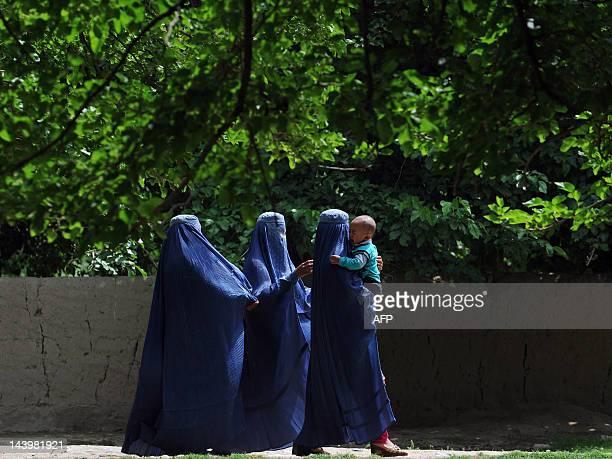 Afghan women walk in the city of Mazari Sharif capital of Balkh province on May 6 2012 Mazari Sharif is the capital of Balkh province with an...
