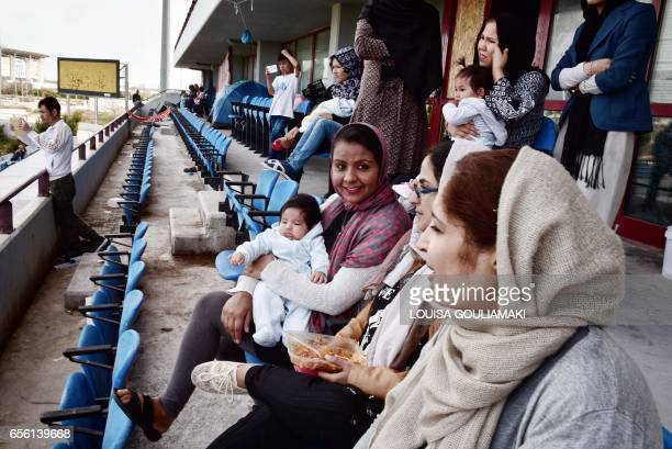 Afghan women watch from tribune the celebrations of Nauroz 'New day' the traditional Afghan New Year's Day on March 21 2017 at the Hockey refugee...