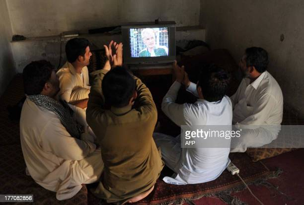 Afghan young men watch the football match between Afghanistan and Pakistan in Jalalabad on August 20 2013 Afghanistan's football team sparked rowdy...