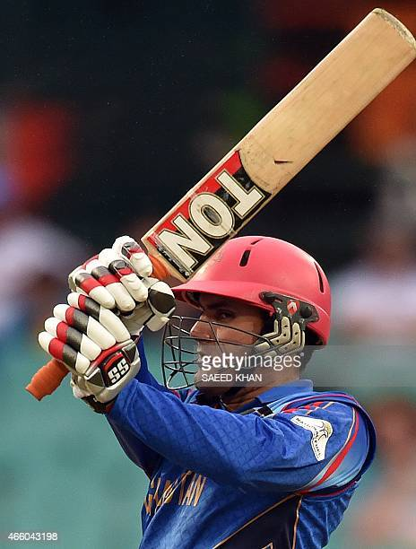 Afghanistan batsman Mohammad Nabi plays a shot during the 2015 Cricket World Cup Pool A match between England and Afghanistan at the Sydney Cricket...