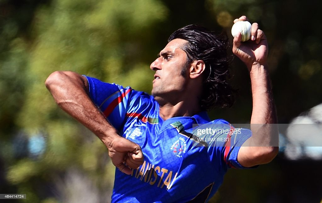 Afghanistan bowler <a gi-track='captionPersonalityLinkClicked' href=/galleries/search?phrase=Shapoor+Zadran&family=editorial&specificpeople=6217332 ng-click='$event.stopPropagation()'>Shapoor Zadran</a> sends down a delivery to the Scotland batsman during their 2015 Cricket World Cup Group A match in Dunedin on February 26, 2015. AFP PHOTO / William WEST