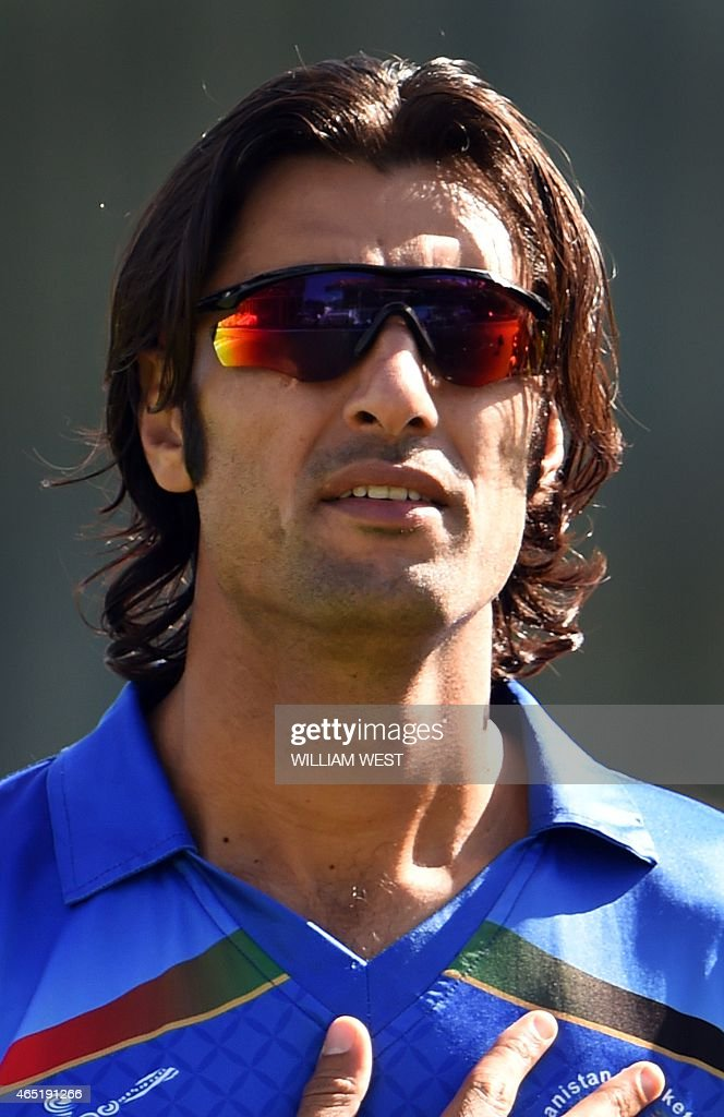 Afghanistan bowler <a gi-track='captionPersonalityLinkClicked' href=/galleries/search?phrase=Shapoor+Zadran&family=editorial&specificpeople=6217332 ng-click='$event.stopPropagation()'>Shapoor Zadran</a> stands for the national anthem before the start of the Afghanistan versus Scotland 2015 Cricket World Cup Group A match in Dunedin on February 26, 2015. AFP PHOTO / William WEST