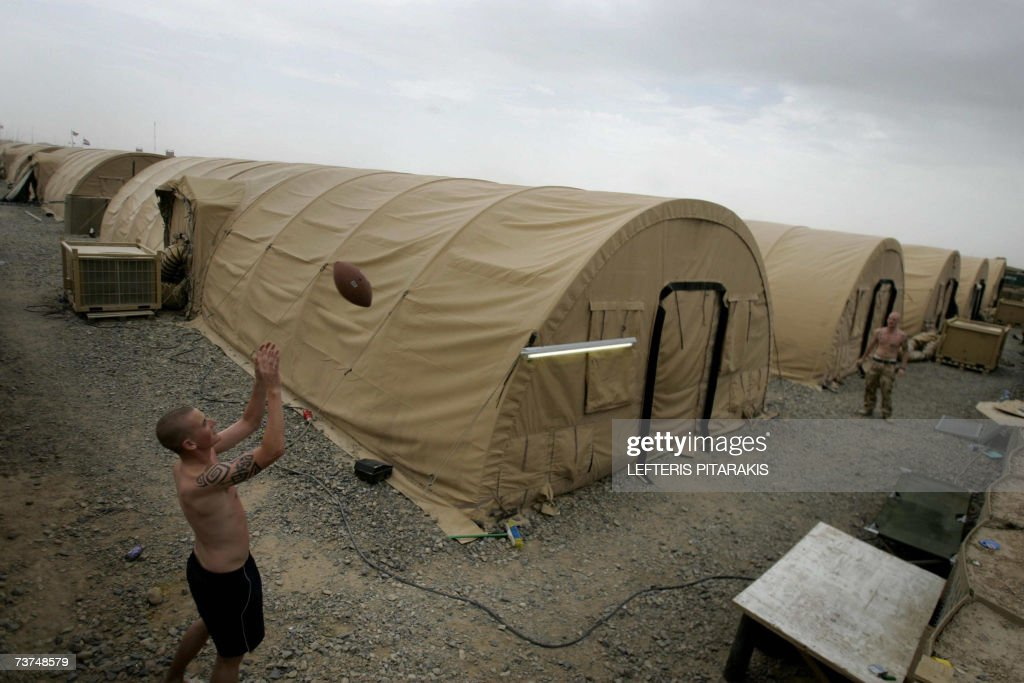 British army soldiers play rugby at the Camp Bastion in Helmand province southern Afghanistan 30 March 2007 Britain's leaderinwaiting Gordon Brown...