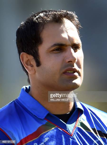 Afghanistan captain Mohammad Nabi stands for the national anthem before the start of the Afghanistan versus Scotland 2015 Cricket World Cup Group A...