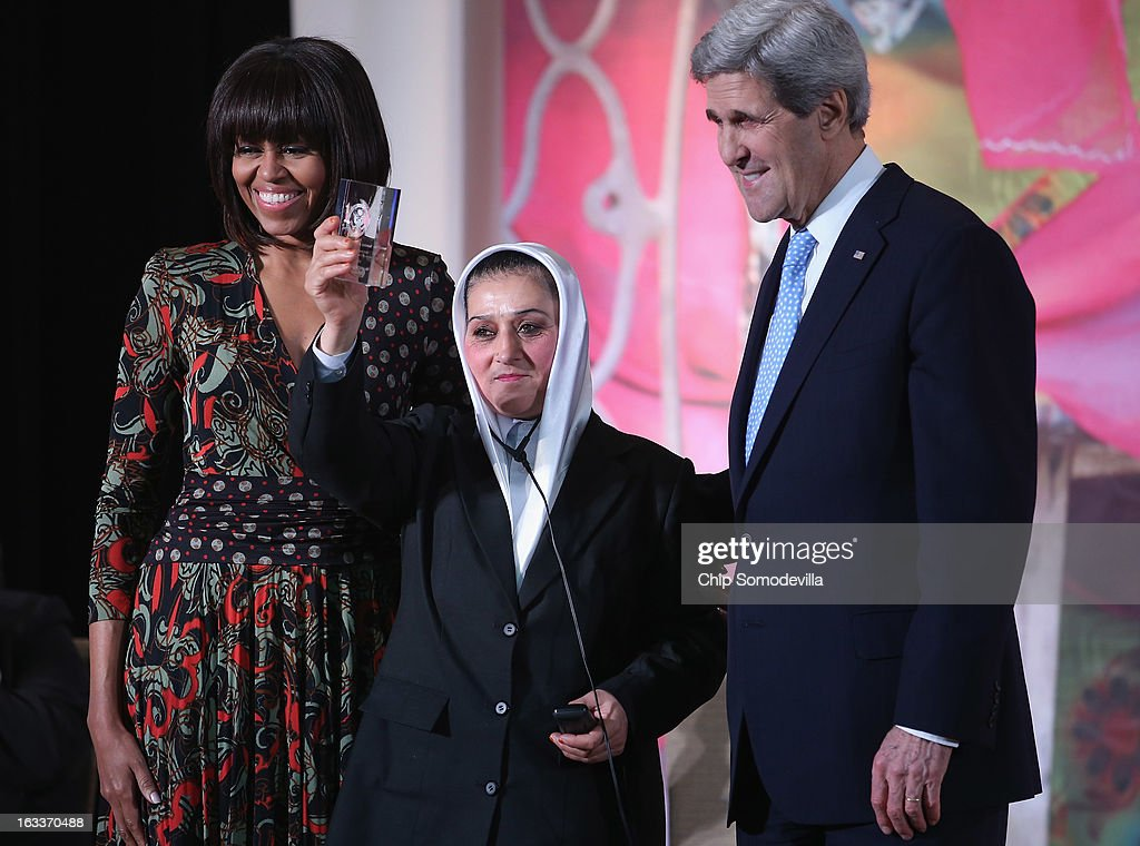 Afghanistan Counter Narcotics Police First Sergeant Malalai Bahaduri (C) holds up her International Women of Courage award while posing for photographs with U.S. first lady Michelle Obama (L) and U.S. Secretary of State John Kerry at the State Department March 8, 2013 in Washington, DC. In celebration of the 102nd International Women's Day, the State Department honored nine women from around the world with the International Women of Courage Award, including the 23-year-old Indian woman known only as 'Nirbhaya,' who died from injuries she received after being gang raped by six men last December in Delhi.