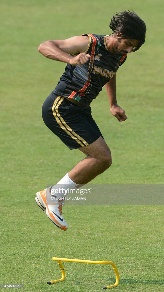 Afghanistan crickeer Shapoor Zadran takes part in a team training session at the Sher-e-Bangla National Cricket Stadium in Dhaka on February 24, 2014. AFP PHOTO/Munir uz ZAMAN