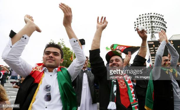 Afghanistan cricket fans celebrate taking the first wicket during the one day match at Lord's London