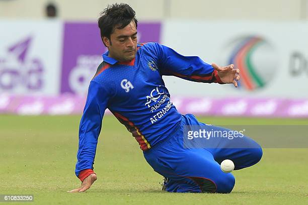 Afghanistan cricketer Rashid Khan fields the ball during the second One Day International cricket match between Bangladesh and Afghanistan at the...