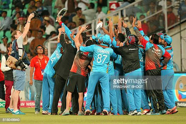 Afghanistan cricketers celebrate after winning their T20 World Cup cricket match against Zimbabwe at the VCA stadium in Nagpur on March 12 2016 / AFP...