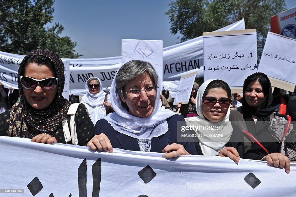 Afghanistan head of Human Rights Commision Seema Samar (C) marches with Afghan women to protest the recent public execution of a young woman for alleged adultery, in Kabul on July 11, 2012. Dozens of Afghan women's rights activists took to the streets July 11 to protest the recent public execution of a young woman for alleged adultery, which was captured in a horrific video. AFP PHOTO/Massoud HOSSAINI