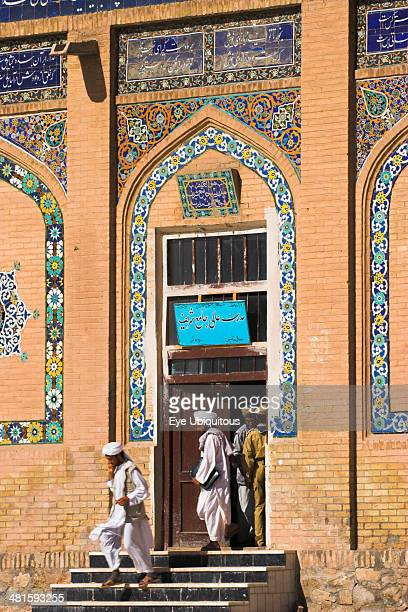 Afghanistan Herat Men leaving Friday Mosque or MasjeteJamOriginally laid out on the site of an earlier 10th century mosque in the year 1200 by the...