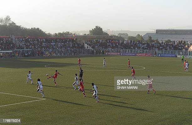Afghanistan national footballers compete with Pakistan players during a football match at the Afghanistan Football Federation stadium in Kabul on...