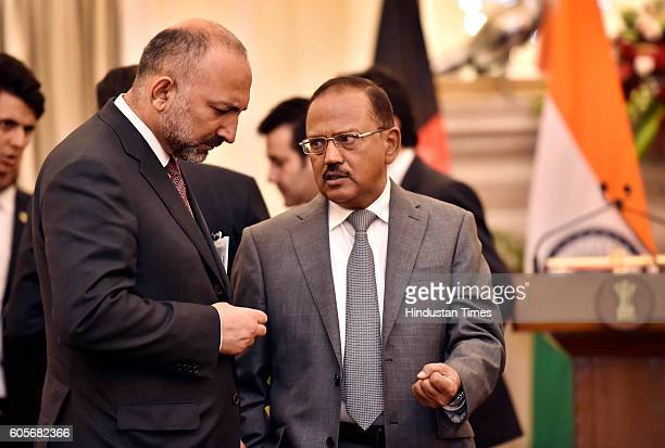 Afghanistan National Security Advisor Mohammad Hanif Atmar and Indian counterpart Ajit Doval prior to the agreement signing ceremony following...