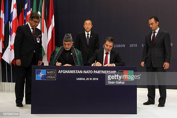 Afghanistan President Hamid Karzai and NATO Secretary General Anders Fogh Rasmussen sign a declaration for the AfghanistanNATO partnership as United...