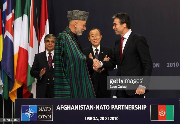 Afghanistan President Hamid Karzai and NATO Secretary General Anders Fogh Rasmussen shake hands after signing a declaration for the AfghanistanNATO...