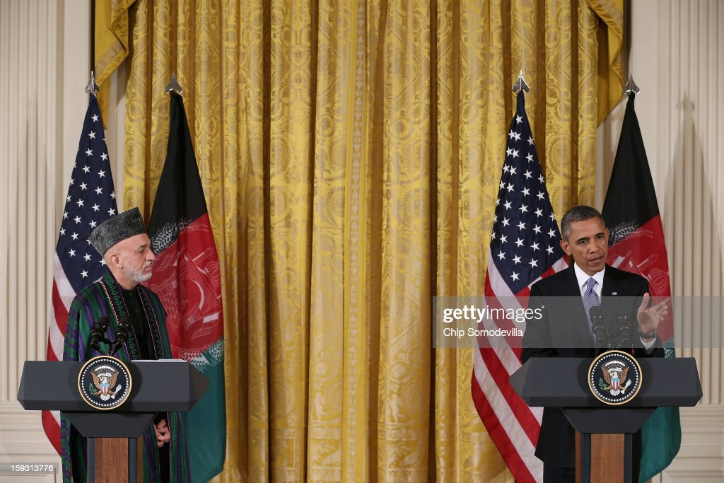 Afghanistan President <a gi-track='captionPersonalityLinkClicked' href=/galleries/search?phrase=Hamid+Karzai&family=editorial&specificpeople=121540 ng-click='$event.stopPropagation()'>Hamid Karzai</a> (L) and U.S. President <a gi-track='captionPersonalityLinkClicked' href=/galleries/search?phrase=Barack+Obama&family=editorial&specificpeople=203260 ng-click='$event.stopPropagation()'>Barack Obama</a> hold a joint news conference in the East Room of the White House January 11, 2013 in Washington, DC. Karzai is in Washington for face-to-face meetings with Obama and senior members of his administration about the future of American commitment to Afghanistan and when troops may leave the country after more than 10 years of war.