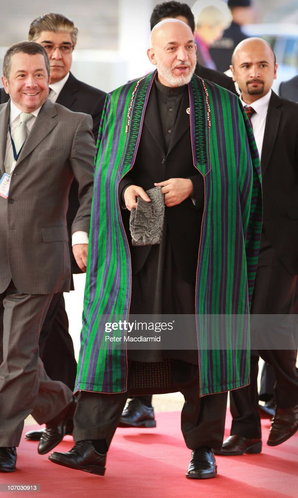 Afghanistan President <a gi-track='captionPersonalityLinkClicked' href=/galleries/search?phrase=Hamid+Karzai&family=editorial&specificpeople=121540 ng-click='$event.stopPropagation()'>Hamid Karzai</a> arrives for day two of the NATO Summit at Feira Internacional de Lisboa (FIL) on November 20, 2010 in Lisbon, Portugal. The two day summit will address issues including a new strategic concept for NATO. Britain and the US will also seek an agreement to hand over responsibility for security in Afghanistan to local forces over the next four years.