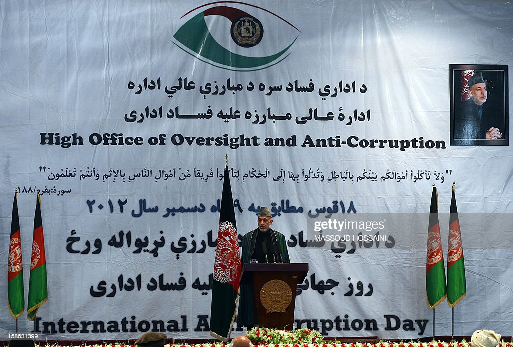 Afghanistan president Hamid Karzai talks during an 'Anti-Corruption' ceremony at the Amani High School in Kabul on December 22, 2012. Karzai on December 22 accused foreign countries for a big part of corruption in his country, ranked one of the most corrupt in the world. Marking the international anti-corruption day in Kabul, Karzai said the corruption in his administration was smaller compared to corruption involving foreigners in Afghanistan. AFP PHOTO/Massoud HOSSAINI