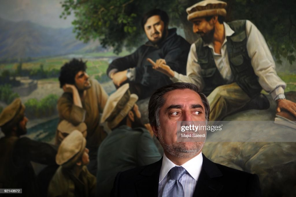 Afghanistan presidential election candidate <a gi-track='captionPersonalityLinkClicked' href=/galleries/search?phrase=Abdullah+Abdullah&family=editorial&specificpeople=695346 ng-click='$event.stopPropagation()'>Abdullah Abdullah</a> gestures as he addresses a press conference at his residence on October 21, 2009 in Kabul, Afganistan. Abdullah the main challenger to Afghan President Hamid Karzai, in Afghanistan's presidential race agreed on October 21 to take part in a run-off election scheduled to take place on November 7, 2009 following the original fraud-tainted vote count.