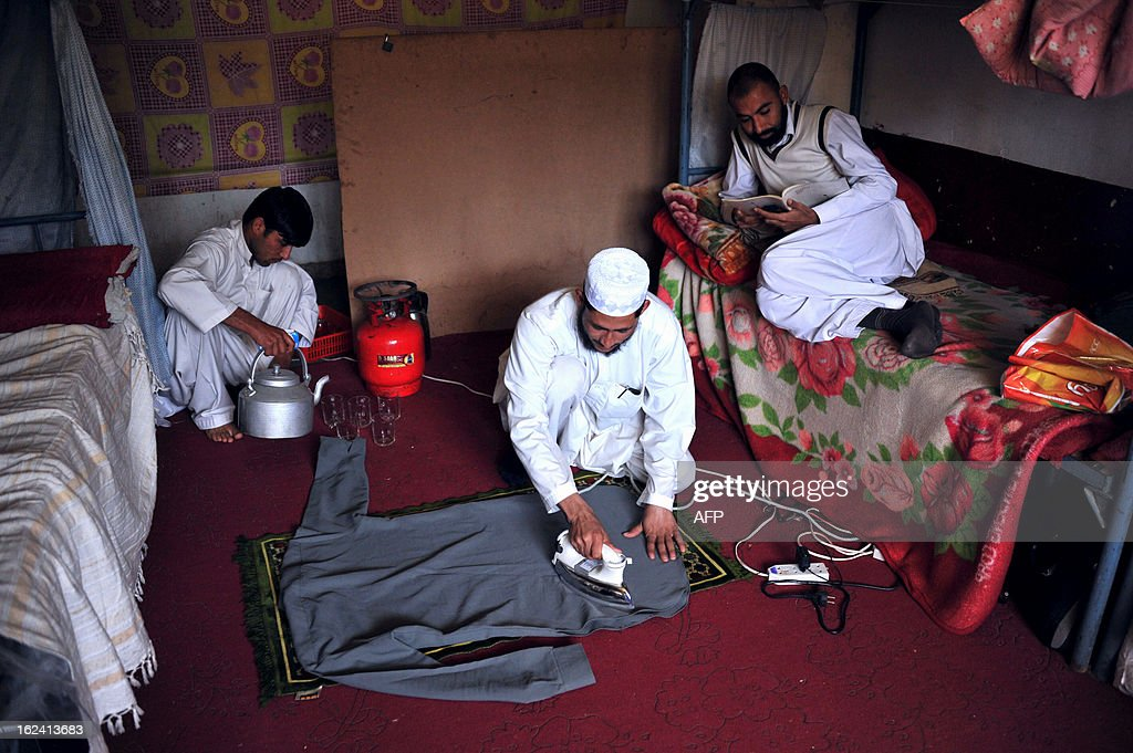 Afghanistan university students study and prepare for the day at a dormitory in Nangarhar university on the outskirts of Jalalabad on February 23 2013. Fighting Taliban militants in Afghanistan consumes most of the country's resources. Rebuilding the educational system is not a political priority and university students face a lot of problem in their education period of time. AFP PHOTO/ Noorullah Shirzada