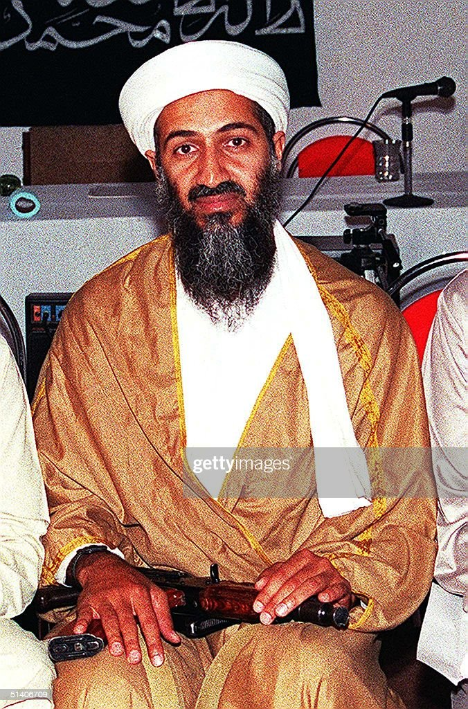 An undated recent file picture shows <a gi-track='captionPersonalityLinkClicked' href=/galleries/search?phrase=Osama+Bin+Laden&family=editorial&specificpeople=120827 ng-click='$event.stopPropagation()'>Osama Bin Laden</a> attending a meeting with a Kalashnikov on his lap in an undisclosed place inside Afghanistan. US Officials have information 'tentatively linking' Saudi fundamentalist millionaire <a gi-track='captionPersonalityLinkClicked' href=/galleries/search?phrase=Osama+Bin+Laden&family=editorial&specificpeople=120827 ng-click='$event.stopPropagation()'>Osama Bin Laden</a>, to the bombing of the US embassies in Nairobi and Dar es Salaam, the New York Times reported Sunday. AFP PHOTO/FILES
