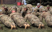 Afghanistanbound soldiers do pushups following a departure ceremony on November 4 2011 in Fort Carson Colorado Some 250 medical soldiers from the US...