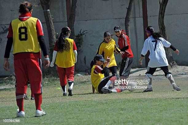 Afghanistanconflictwomensport by Daphné BENOIT Afghanistan's women's national football team members take part in a practice session at a military...