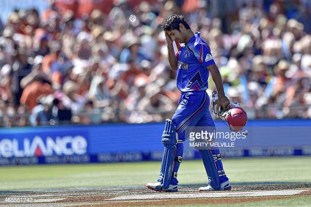 Afghanistan's captain Mohammad Nabi walks from the field after being caught by New Zealand's Ross Taylor during the Pool A 2015 Cricket World Cup...