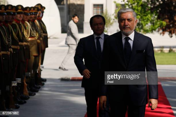 Afghanistan's Chief Executive Abdullah Abdullah arrives to attend a meeting with President Ashraf Ghani and US Defense Secretary James Mattis at the...