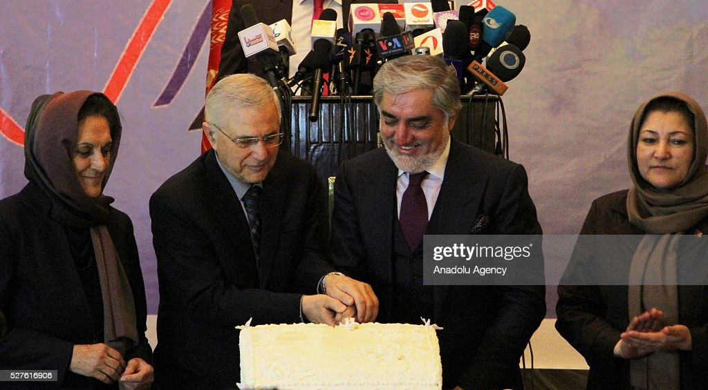 Afghanistan's chief executive Abdullah Abdullah cuts a cake during the World Press Freedom Day in Kabul, Afghanistan on May 3, 2016. World Press Freedom day is observed on 03 May, throughout the world, to inform the public of defilements of the right to freedom of expression.