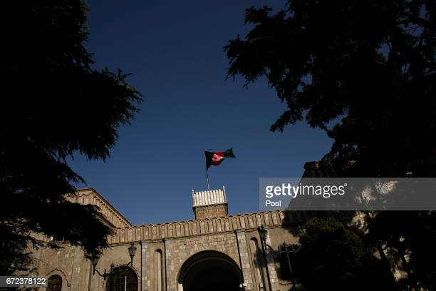 Afghanistan's flag flies over the Presidential Palace as President Ashraf Ghani and US Defense Secretary James Mattis meet April 24 2017 in in Kabul...