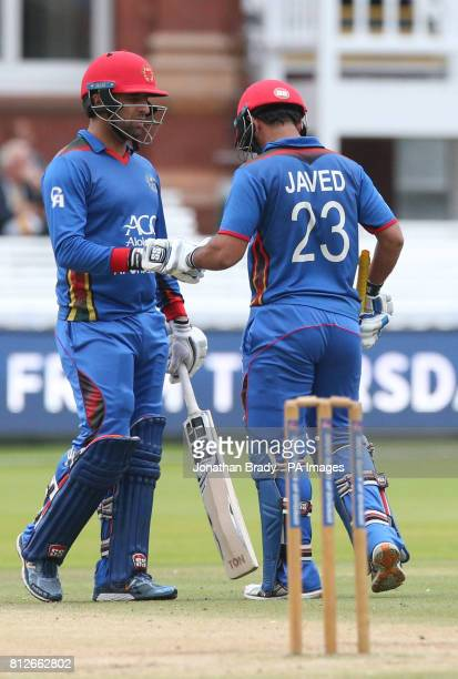 Afghanistan's Javed and Noor Ali bump fists between the wickets during the one day match at Lord's London