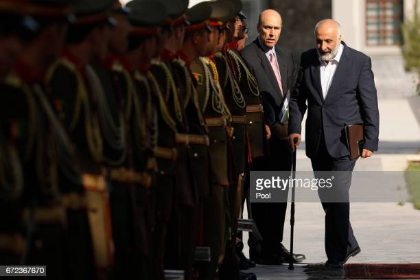 Afghanistan's National Directorate of Security Director Mohammad Masoom Stanekzai arrives to attend a meeting with President Ashraf Ghani and US...