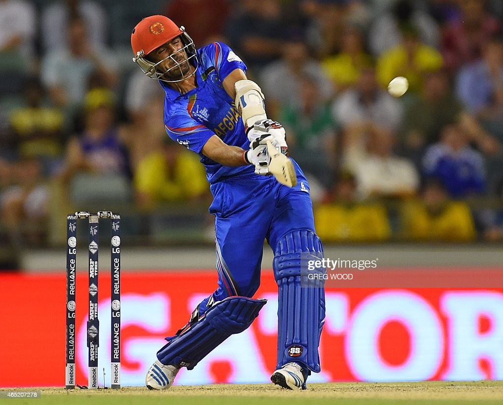Afghanistan's <a gi-track='captionPersonalityLinkClicked' href=/galleries/search?phrase=Nawroz+Mangal&family=editorial&specificpeople=5794122 ng-click='$event.stopPropagation()'>Nawroz Mangal</a> hits a six during the 2015 Cricket World Cup Pool A match between Australia and Afghanistan in Perth on March 4, 2015. AFP PHOTO / Greg WOOD --IMAGE