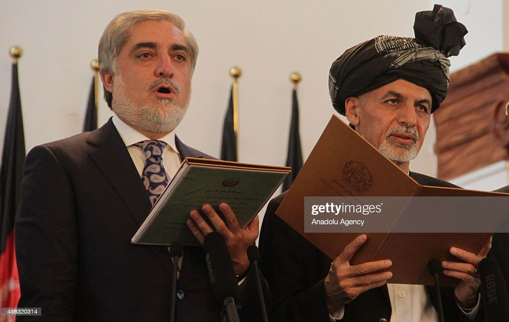 Afghanistan's new President Ashraf Ghani Ahmadzai (C) and Afghanistan's Chief Executive Abdullah Abdullah (L) take the oath during their inauguration in Kabul, Afghanistan on September 29, 2014.