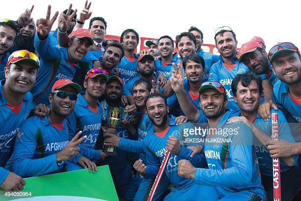 Afghanistan's players pose with the series trophy after they won the fifth and final One Day International cricket match against Zimbabwe at the...