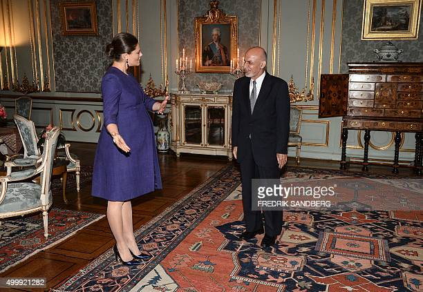 Afghanistan's President Ashraf Ghani is received by Sweden's pregnant Crown Princess Victoria at the Royal Palace in Stockholm Sweden on December 4...