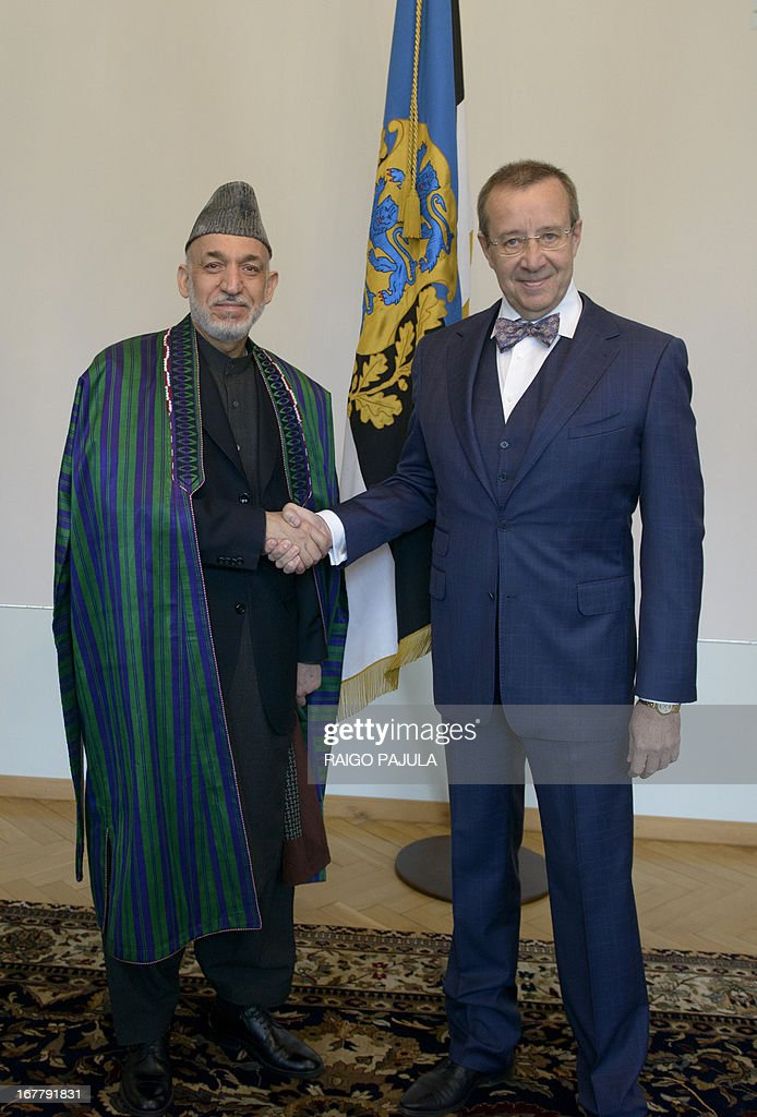 Afghanistan's President Hamid Karzai (L) and Estonian President Toomas Hendrik Ilves (R) shake hands after a meeting in Tallinn, Estonia on April 30, 2013. Karzai arrived on Monday, April 29, 2013 for a two day official visit to the Baltic state.