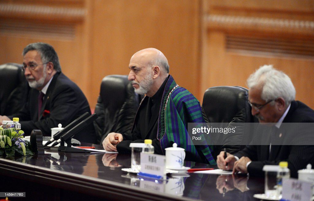 Afghanistan's President Hamid Karzai (C) attends a bilateral meeting with Chinese President Hu Jintao at the Great Hall of the People on June 8, 2012 in Beijing, China. According to reports, China announced that it will provide a 150 million yuan (23.8 million US dollars) grant to the Afghan government during 2012.