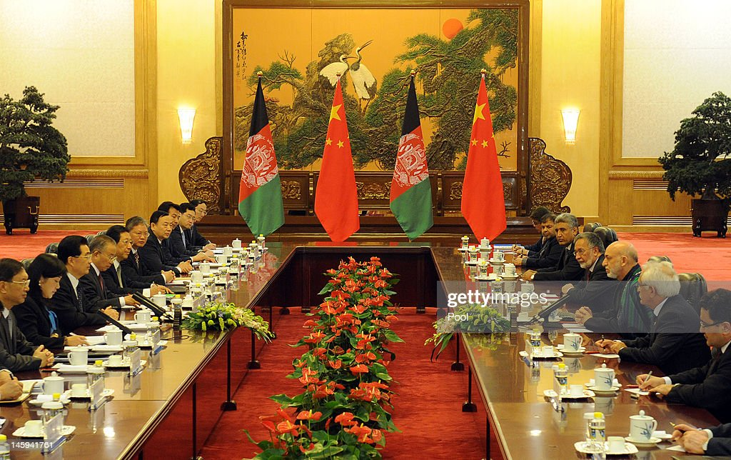 Afghanistan's President Hamid Karzai (Center-R) attends a bilateral meeting with Chinese President Hu Jintao (Center-L) at the Great Hall of the People on June 8, 2012 in Beijing, China. According to reports, China announced that it will provide a 150 million yuan (23.8 million US dollars) grant to the Afghan government during 2012.