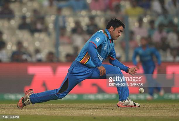 Afghanistan's Rashid Khan fields the ball during the World T20 cricket tournament match between Afghanistan and Sri Lanka at the Eden Gardens in...
