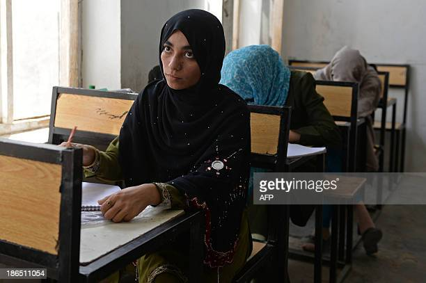 AfghanistanunresteducationchildrenFEATURE by Ben Sheppard In this picture taken on September 25 Shamsia Husseini looks on as she attends a teacher...