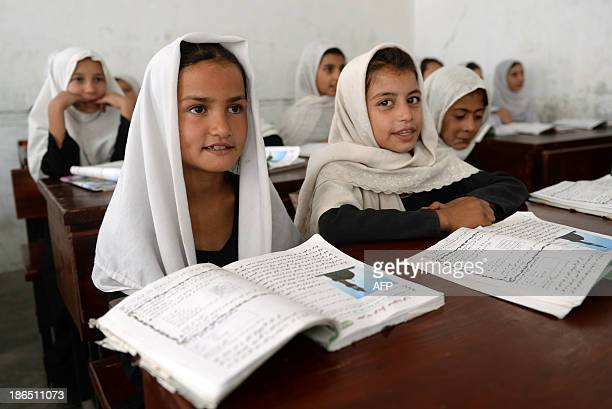 AfghanistanunresteducationchildrenFEATURE by Ben Sheppard In this picture taken on September 25 schoolgirls listen as they sit in Shamsia Husseini's...