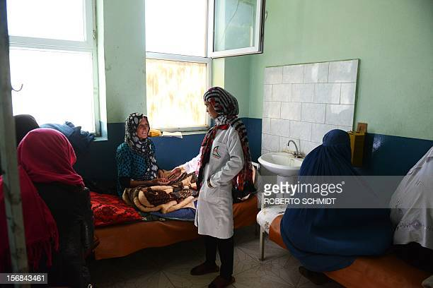AfghanistanunresthealthwomenFOCUS This photo taken on October 6 2012 shows midwife Nasira Karimi tending to a woman who recently gave birth at a...