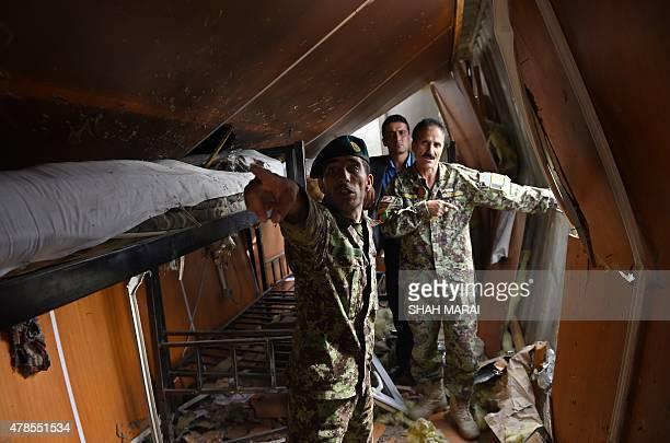 Afghanistanunrestmilitarysuperhero FOCUS by Usman Sharifi In this photograph taken on June 24 Afghan soldier Essa Khan Laghmani explains how he shot...