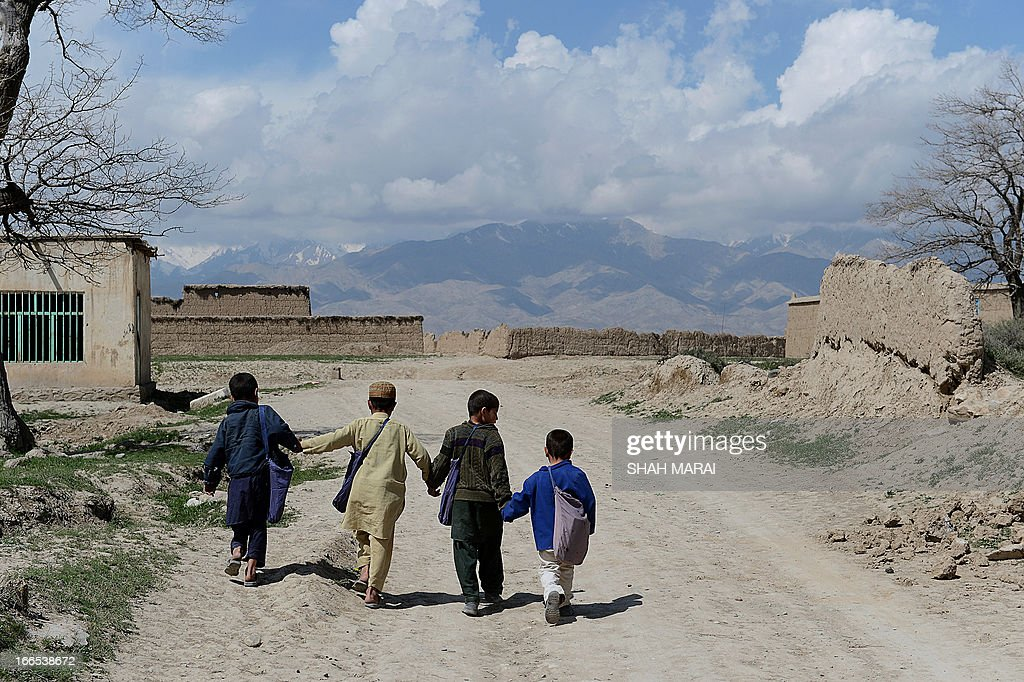 Afghanistan-US-UN-education-Hollywood-people; by Sardar Ahmad In this picture taken on April 3, 2013, Afghan schoolboys walk down a road after a lesson in a new school at Qala-i-Gudar village in Qarabagh district Kabul province. At a school in a bombed-out Afghan village near Kabul, Angelina Jolie is known as an aid worker or engineer -- never as one of the world's most famous film stars. Jolie, a special envoy of the UN High Commissioner for Refugees, built the school in Qala-i-Gudar last year and is planning to open more in Afghanistan with profits from a newly-launched jewellery line that she has designed. The Hollywood star visited Qala-i-Gudar in 2011, and she retains an avid fan base among residents who have never seen any of her films and have no idea about her global fame as an actress. AFP PHOTO/ SHAH Marai