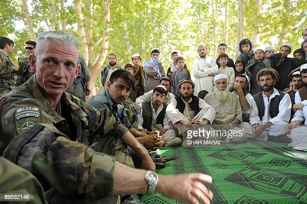 AfghanistanvotesecurityFrance BY MARC BASTIAN In this picture taken on July 27 Afghan village elders listen to French Colonel Francis Chanson...