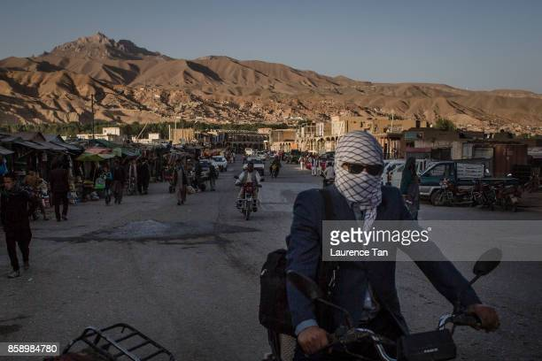 Afghans commute on motorbikes along the Bamiyan bazaar on August 14 2017 in Bamiyan Afghanistan Located in central Afghanistan Bamiyan is situated...