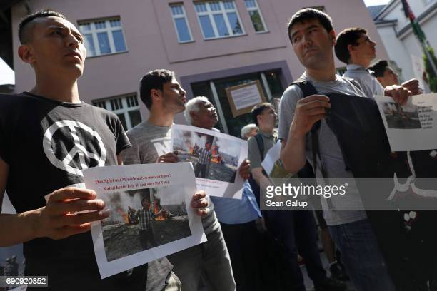 Afghans protesting against deportations hold up photos of today's bombing in Kabul outside the Afghan Embassy on May 31 2017 in Berlin Germany The...