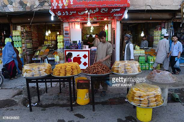 Afghans shop in a busy market during the Islamic holy month of Ramadan in Herat on June 25 2015 Across the Muslim world the faithful fast from dawn...